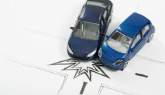 Two toy cars on a hand drawn road map colliding on the road.