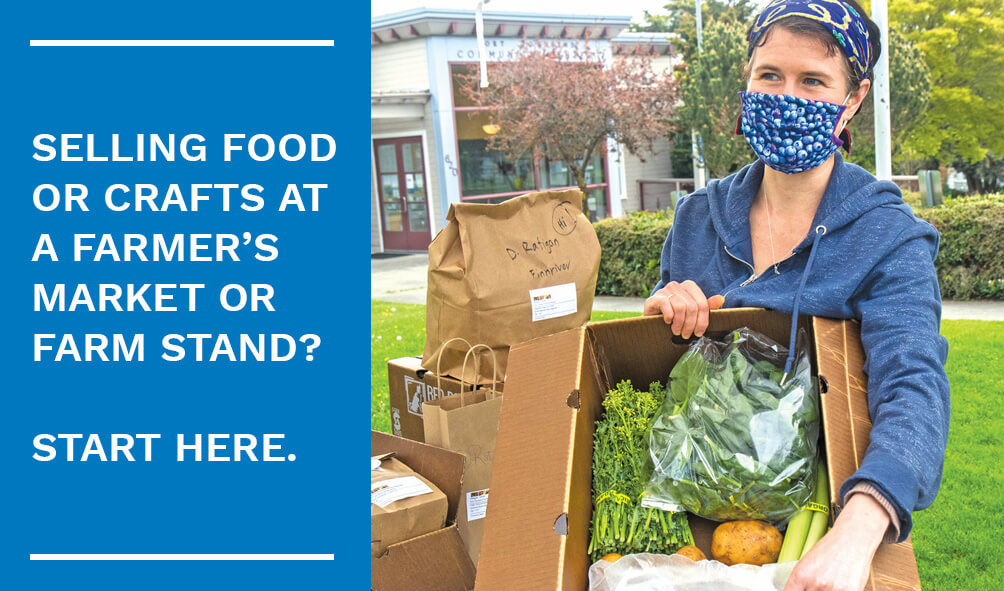 """Image of woman wearing a mask with blueberries on it holding a cardboard box of vegetables at a farmers market. On left, large blue rectangle with the text, """"Selling food or crafts at a farmer's market or farm stand? Start here."""""""