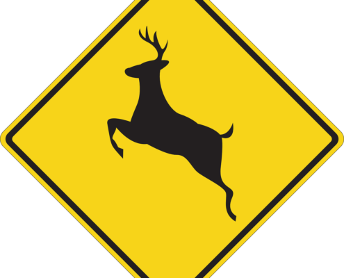 Yellow deer crossing sign