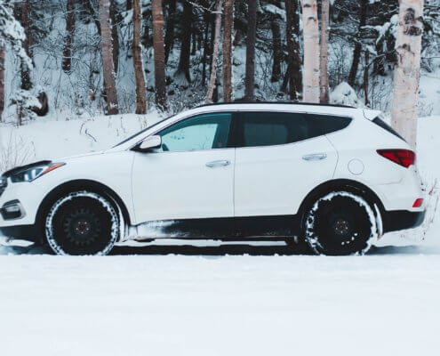 A white vehicle in the snow