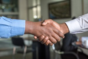 A close up of two people shaking hands